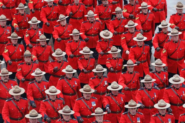 Jan. 18, 2011 - Toronto - The RCMP red surge arrives at the Metro Toronto Convention Center for the day's activities surrounding the color funeral for a fallen Toronto Police officer.  Sgt. Ryan Russell  was struck and killed by a stolen snowplow early on